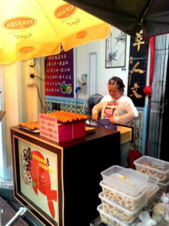 Try local food and buy souvenirs at Jonker's Way